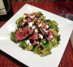 Strip Steak Over Shaved Brussels Sprouts